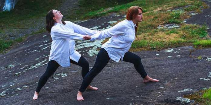 Rebecca Wolfe and Margaret Muriel Legere perform in the Caravan Theatre production of Sarah Kane's 4.48 Psychosis.